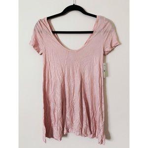 Never been worn. Light pink shimmer blouse